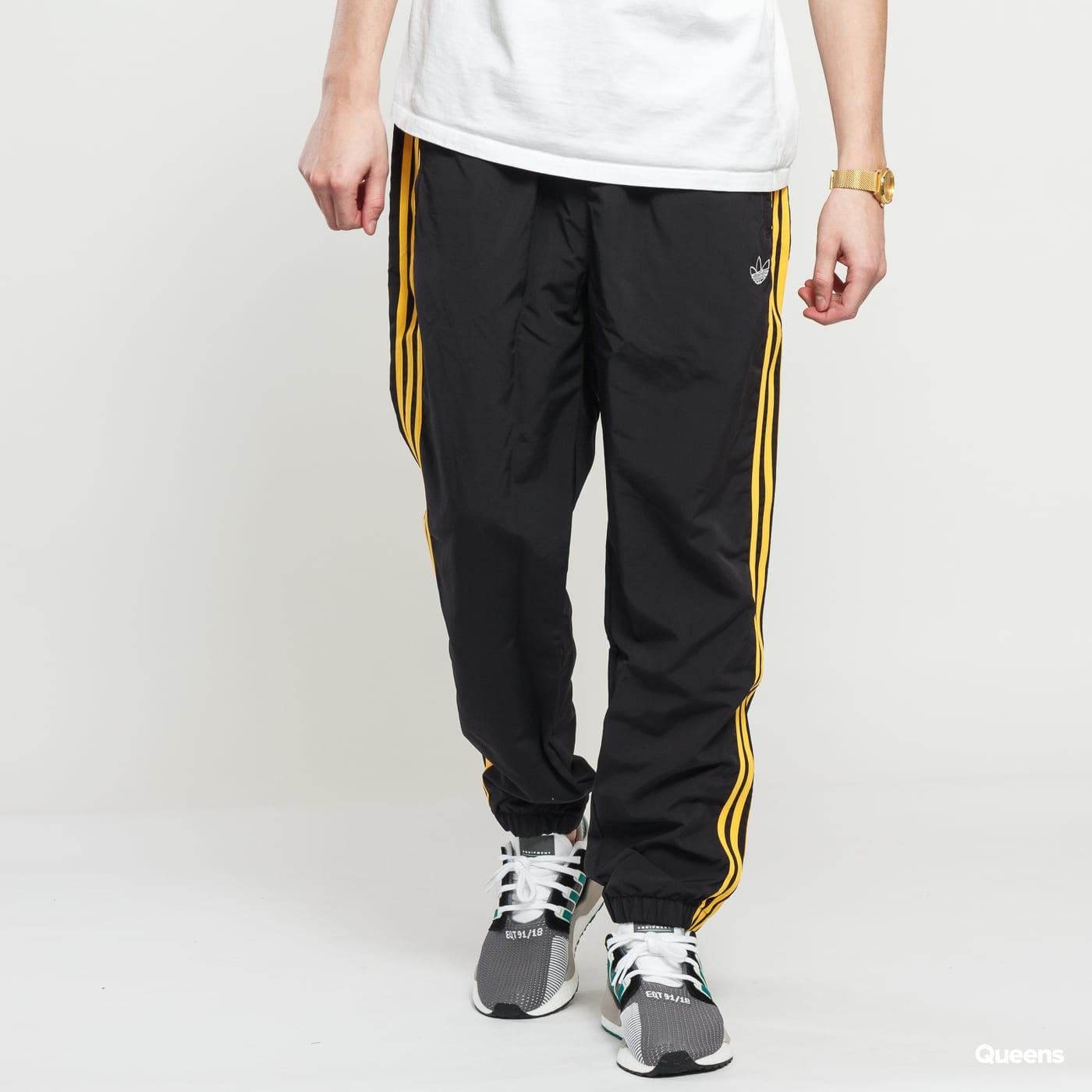 5b10ce30 adidas Originals Woven 3 Stripes Pant black / yellow