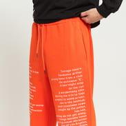 PLEASURES Teenagelover Sweatpants oranžové
