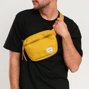 The Herschel Supply CO. Fifteen Hip Pack tmavě žlutá