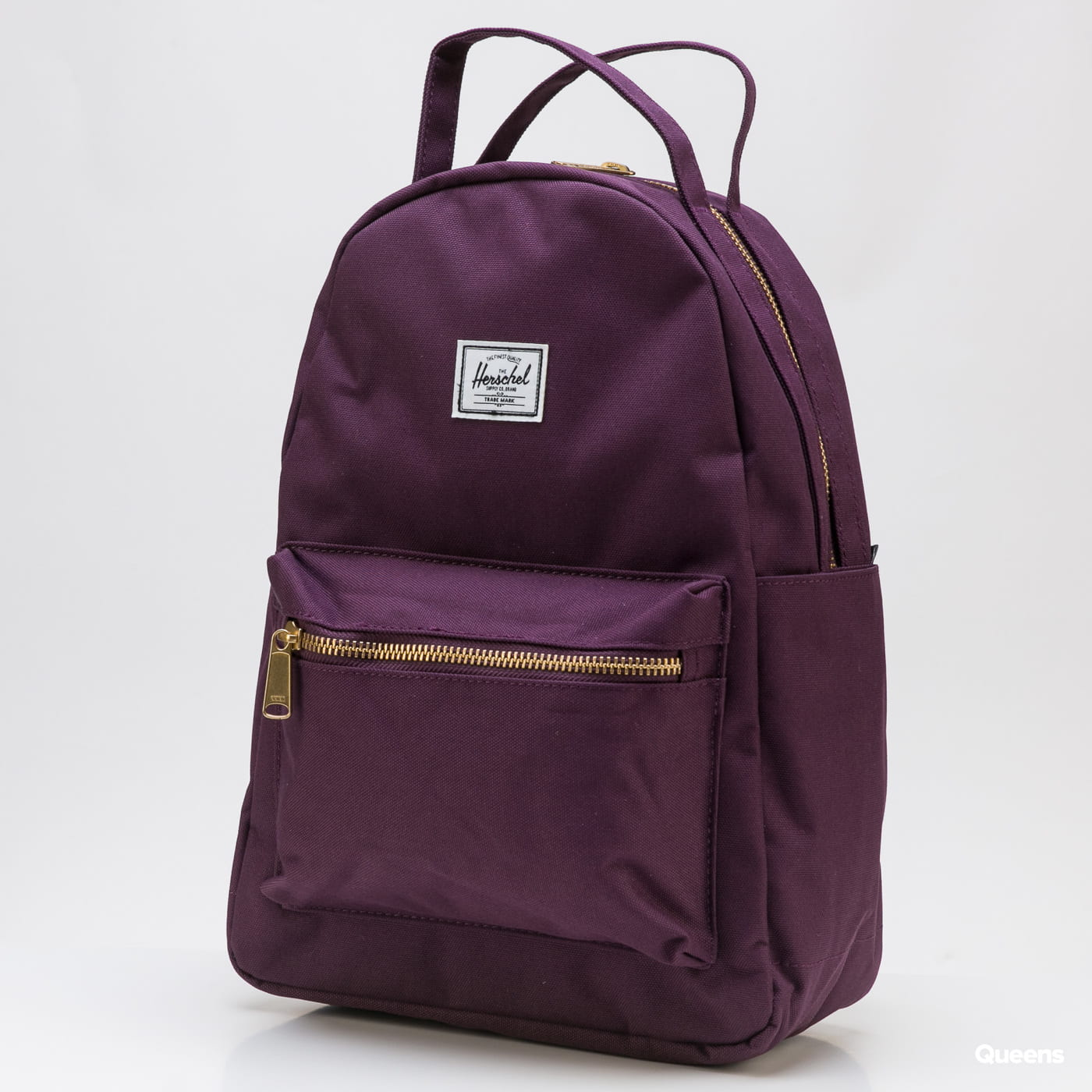 The Herschel Supply CO. A mini backpack from The Herschel Supply CO. in a purple colorway with golden details.- backpack- handle for carrying in hand- adjustable pad A mini backpack from The Herschel Supply CO. in a purple colorway with golden details.- backpack- handle for carrying in hand- adjustable pad
