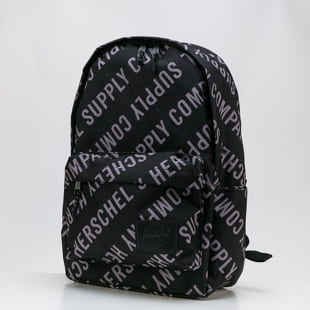The Herschel Supply CO. A backpack from The Herschel Supply CO. in a black colorway with a front part and an all over motive.- backpack- handle for carrying in hand