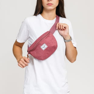 The Herschel Supply CO. A waist bag from The Herschel Supply CO. in a pink colorway with a pink stripe and a decent front logo.- waist bag- adjustable strap with buckl