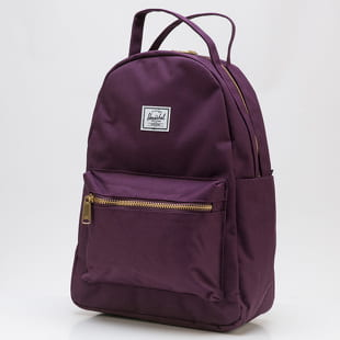 The Herschel Supply CO. A mini backpack from The Herschel Supply CO. in a purple colorway with golden details.- backpack- handle for carrying in hand- adjustable pad