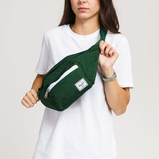 The Herschel Supply CO. A waist bag from Herschel Supply CO. in a dark green colorway with a green strap and a decent front logo.- waist bag- adjustable strap with a b